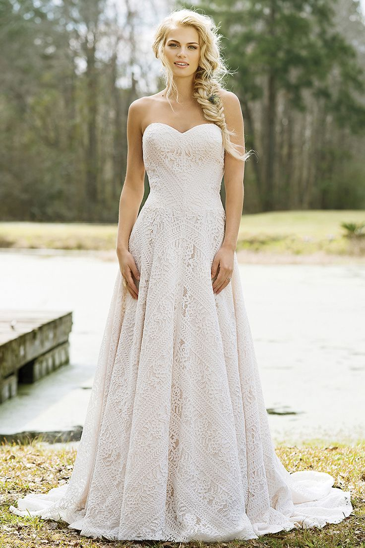 Wedding gown by Lillian West.
