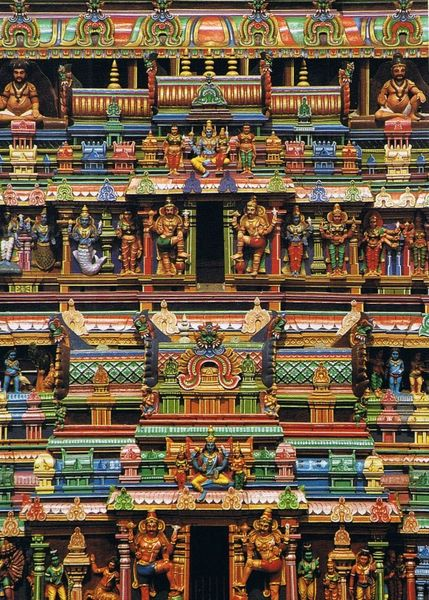 The intricate sculptures of deities on Madurai temple create fractal-like patterns