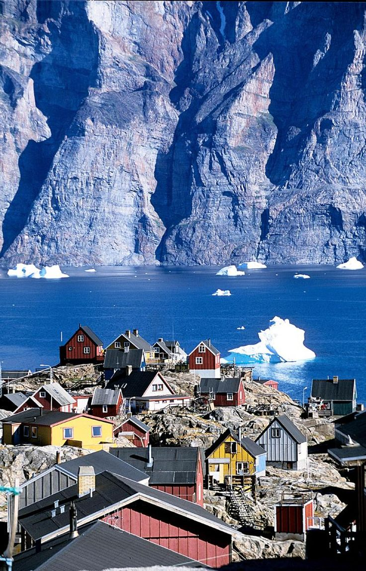 Beautiful Greenland!!! ......Colorful homes overlook a large cliff across the water along the shore of Greenland. (Jens Henrik Nybo/Greenland Tourism)