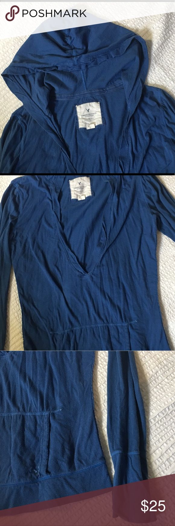 Women's AE hoodie long sleeve size M Super long sleeve  Great blue color Deep V neck Light weight material Extra long cuffs and lower hem White stitching Dropped waist length  I always wear these with skinny jeans or leggings and a white cami. Great for spring or summer mornings. American Eagle Outfitters Tops Tees - Long Sleeve