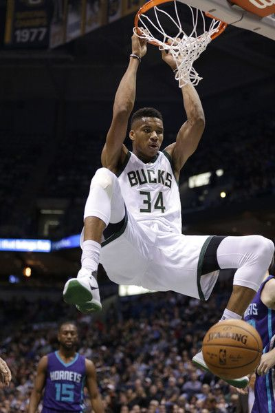 Giannis Antetokounmpo #34 of the Milwaukee Bucks slam dunks the basketball during the first quarter against the Charlotte Hornets at BMO Harris Bradley Center on October 26, 2016 in Milwaukee, Wisconsin. NOTE TO USER: User expressly acknowledges and agrees that, by downloading and or using this photograph, User is consenting to the terms and conditions of the Getty Images License Agreement.