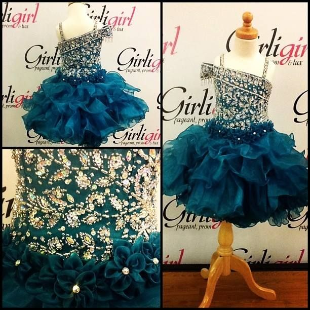 ADORABLE little girls emerald green pageant dress!! This is perfect for a glitz pageant!! 74 East Main St. Buford GA 30518 Phone:770-831-8795
