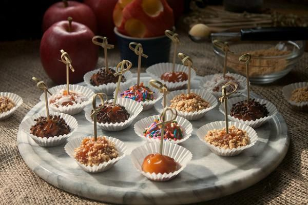 These fun and festive, beautiful mini caramel apple bites are the perfect recipe for your Halloween party. A bite-size treat kids and adults will love!