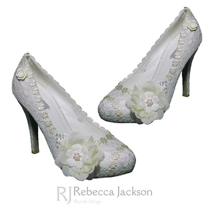 Rebecca Jackson 'Bridget' Bespoke Bridal Shoes.  	Beautiful lace flowers are hand sewn with small ivory satin flowers and hand beaded with ivory Swarovski pearls and crystals in the centre of each to create beautiful flower corsages. The sewn flowers are applied to an ivory lace shoe base and a
