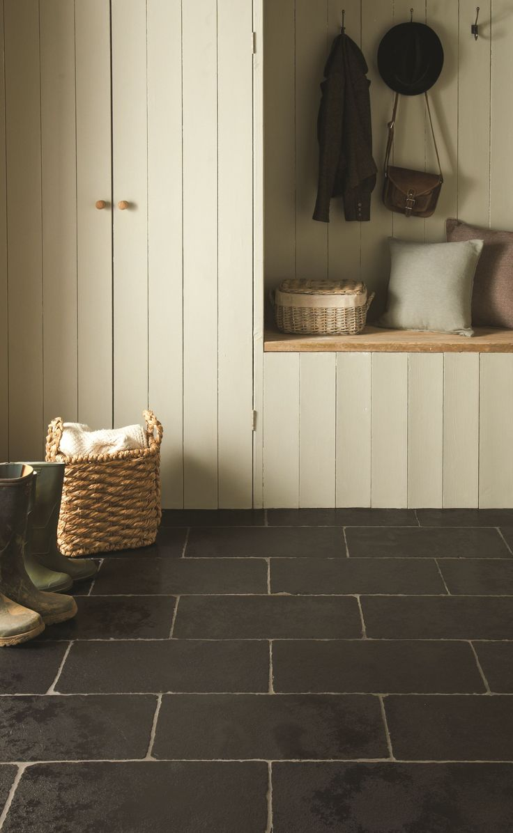 Greyfriars limestone tiles in black look really striking in an entrance or hallway. From originalstyle.com