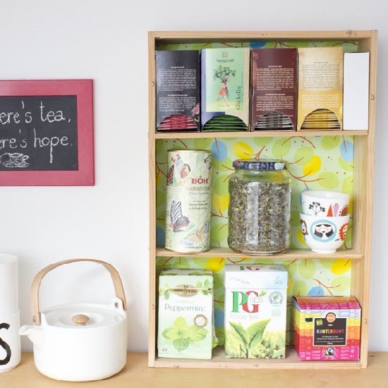 Can you guess what I made this shelf to organize (some of) my tea selection from? Hint: All materials are upcycled...