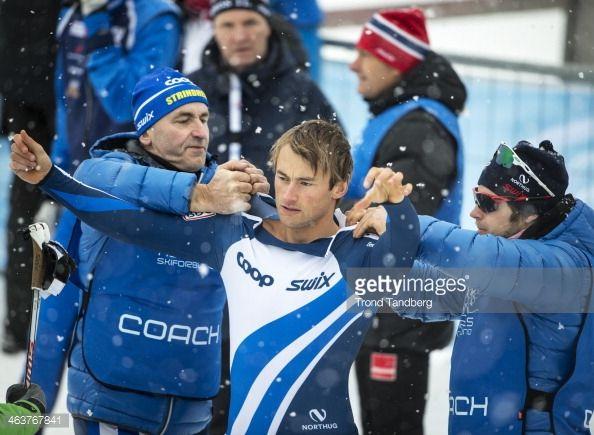 News Photo : Petter Northug gets help from father John Northug...
