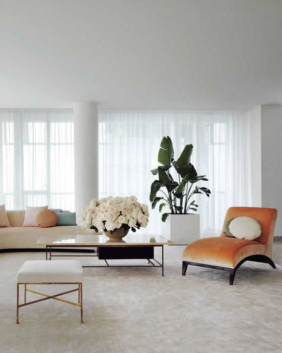 "By Kevin Sharkey Alexis Stewart's apartment is minimalist yet soft, thanks to the feminine color palette, curved furniture silhouettes, and simple but impactful sheer curtains that allow the light to flood in. ""Finding the right window treatments was a big priority for me,"" says Alexis. In the living room, she decorated with midcentury-modern finds, such as the coffee table, console, and benches designed by Paul McCobb and the long kidney-shaped sofa that she bought at an auction. ..."