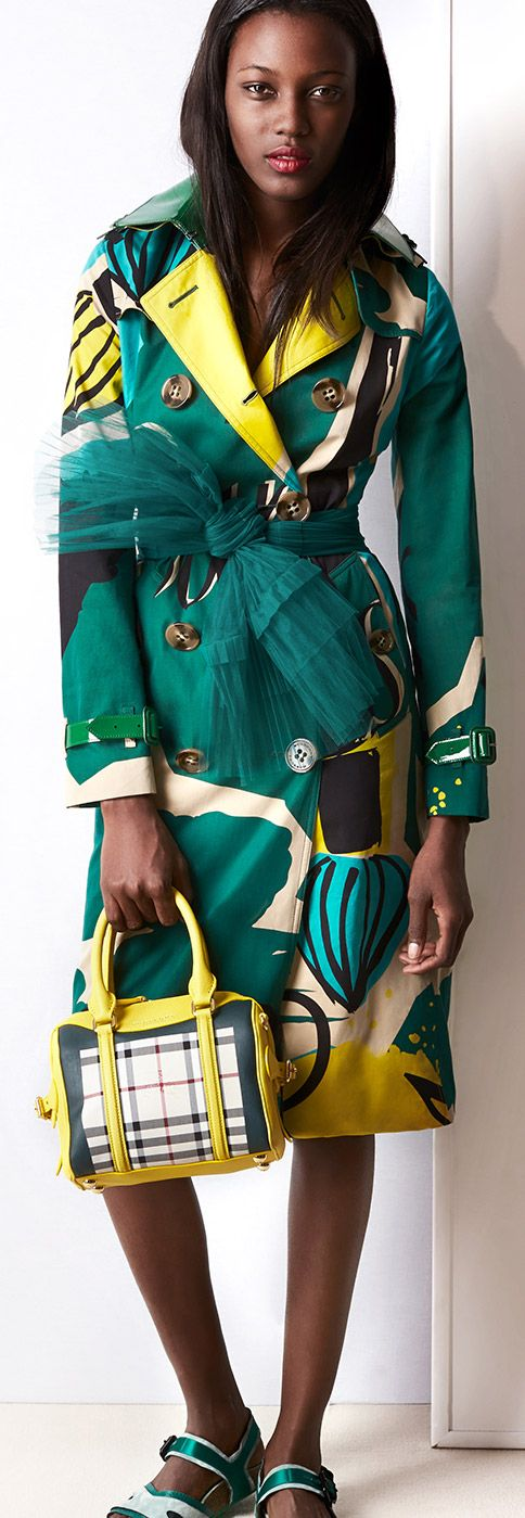 A book cover print trench worn with The Mini Bee bag and a dragonfly tulle belt
