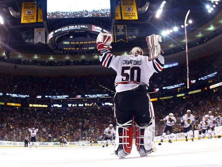 Chicago Blackhawks goalie Corey Crawford celebrates after defeating the Boston Bruins 3-2 in Game Six of the 2013 NHL Stanley Cup finals Harry How/Getty Images
