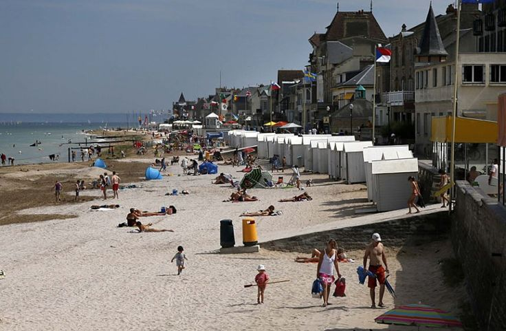 D-Day revisited: how landscapes scarred by war in 1944 look today - Telegraph The modern view: tourists enjoy the sunshine on the former Juno Beach D-Day landing zone, where Canadian forces came ashore, in Saint-Aubin-sur-Mer, France Picture: REUTERS/Chris Helgren
