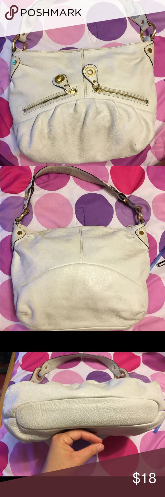 White B Makowsky handbag. White B Makowsky handbag. Measurements are: width is 11 inches, length is 10 inches, side is 3 inches and handle is 18 inches. Clean from inside, dirty from the outside(can be cleaned with leather cleaner). It is a really soft leather. Price is firm. B Makowsky Bags