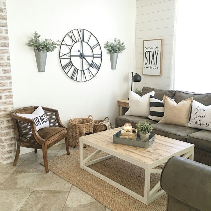 Farmhouse Clock And Flowers In Living Room