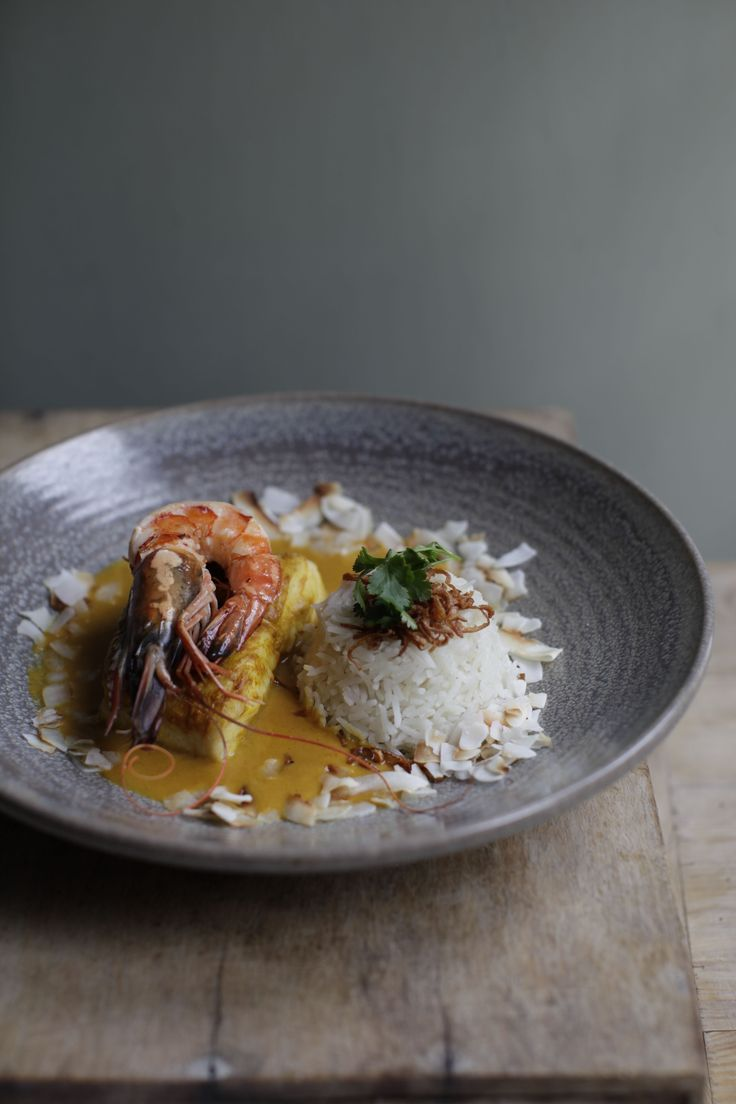 MALABAR FISH CURRY WITH TOASTED COCONUT, grilled king prawn, shallot crisps, coconut rice