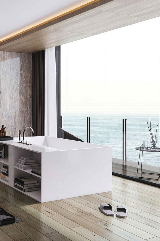 Beautiful modern bath with floor to ceiling windows leading to a balcony with a view to die for. Living Pursuit