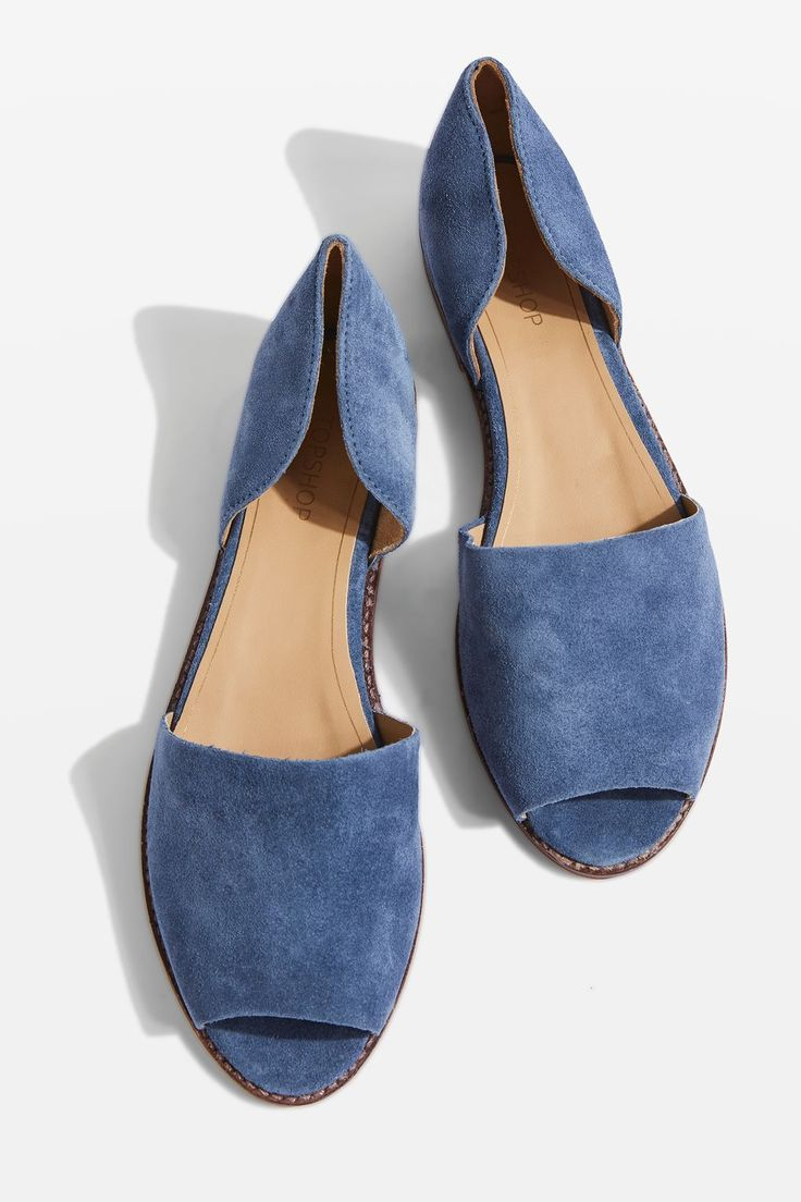An easy slip-on style, these shoes are perfect for the girl who lives in flats. Crafted in a blue suede leather, they are finished with peep-toe detail.