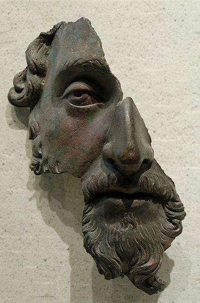 Marcus Aurelius, Bronze, Louvre Fragment of a bronze portrait. Roman artwork, after 170 CE.