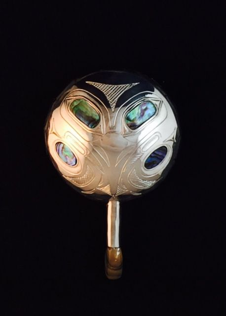 Silver Raven Rattle pendant with abalone inlay by Barry Wilson (Haisla).