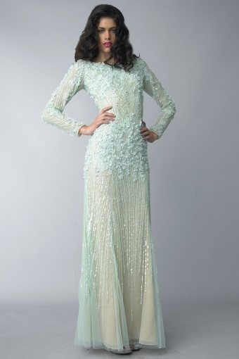 Long sleeve evening gown with a motif of laser cut flowers and sequins