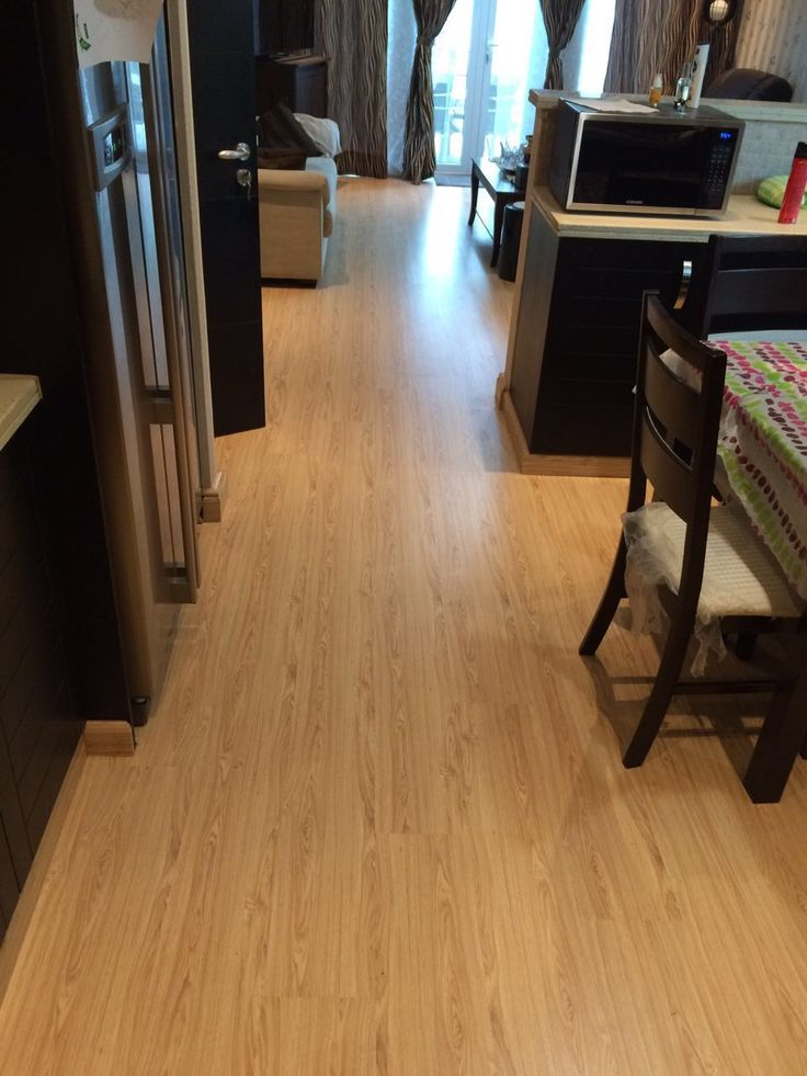 Laminate Flooring Installed On The Entire Living Room Makes The Area Spacious And Homely To