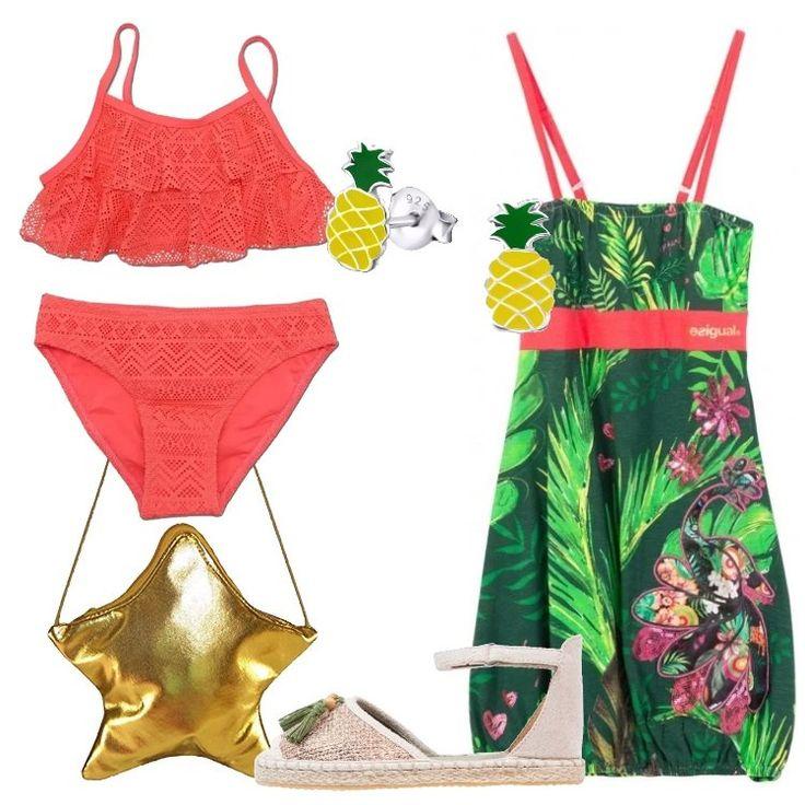 Un outfit da spiaggia per la nostra bambina: vestito Desigual verde, in fantasia tropicale, spalline sottili, elastico sul fondo, bikini rosso, volant, dettagli in pizzo. Sandalo flat bronzo e beige, cinturino alla caviglia, nappine, borsa a tracolla dorata a stella, orecchini a forma di ananas.