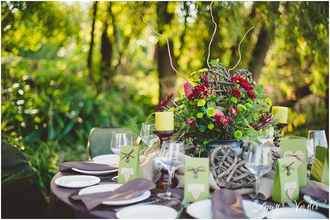 A general view of the table, you can see the brown willow sticks placed in the flower center pieces as well.