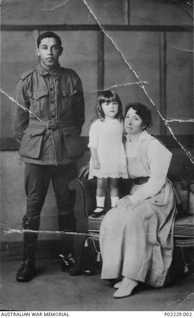 Grafton, NSW. c. 1917-11. Studio portrait of 3662 Private Harold Arthur Cowan, an Aboriginal Australian soldier in 6th Light Horse Regiment (LHR), his cousin Hazel Williams and her baby sister (name unknown). Cowan (also known as Arthur Williams) enlisted at Grafton on 1917-11-16. In his youth Cowan was an all round sportsman, a representative for the North Coast in football, and a well known boxer.