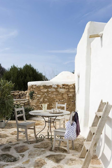 This house is in Formentera (Balearic Islands / Spain )   I love the contrast of white with dark brown, the rustic materials and the relaxed atmosphere.   Ingrid House by Jordi Canosa