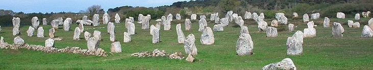 The Carnac stones are an exceptionally dense collection of megalithic sites around the French village of Carnac, in Brittany, consisting of alignments, dolmens, tumuli and single menhirs. The more than 3,000 prehistoric standing stones were hewn from local rock and erected by the pre-Celtic people of Brittany, and are the largest such collection in the world. The stones were erected at some stage during the Neolithic period, probably around 3300 BC, but some may date to as old as 4500 BC.