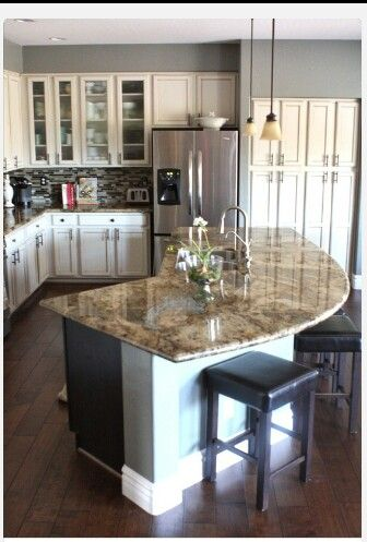 Kitchen island. Love this shape.