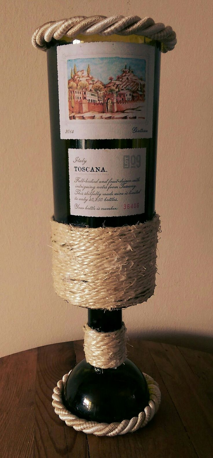 Wine bottle cut and altered. Can be used as a candle holder or vase.