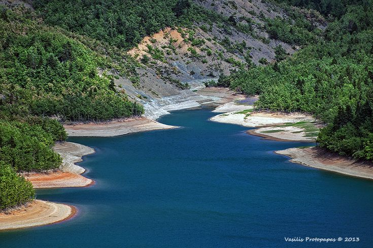 Plastira Lake oso called Tavropos Reservoir is an artificial lake fed by Tavropos (Megdovas) River, located in Karditsa regional unit, near de city of Karditsa, Thessaly_ Greece