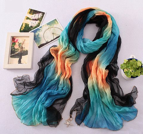 Float away with this light, silky scarf that's dip dyed with bold colors inspired by the ocean. A gem-encrusted sea star hangs from one end, adding a dash of glitz to your outfit. www.lanvieusa.com