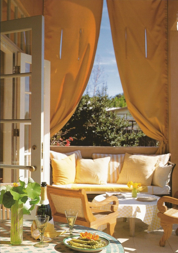 in the home of buzz yudell and tina beebe the golden southern california sun gives the terrace the ambience of eternal summer generous curtains create the