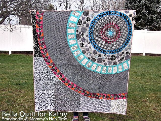 Bella Quilt Finished by emedoodle of Mommy's Nap Time.  She started with a pattern for a NY Beauty block and then went her own way, designing as she went along, making her own paper piecing patterns until this beauty was finished.
