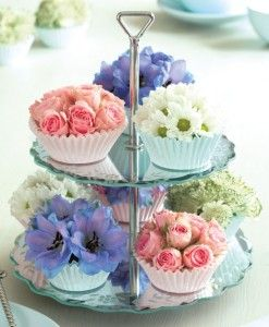 Cupcakes cases filled with flowers make a gorgeous and easy table centrepiece.