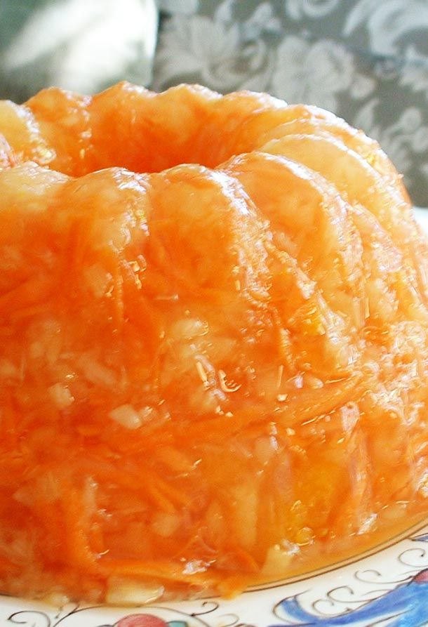 Classic retro sunshine Jello salad recipe, with lemon Jello, grated carrots, and crushed pineapple. On SimplyRecipes.com