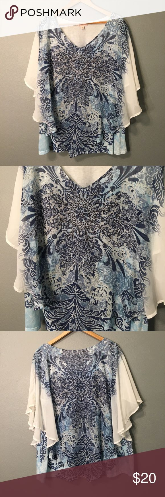 Blue and white blouse with floral prints Gorgeous blouse with semi sheer overlay with butterfly sleeves. Tops Blouses