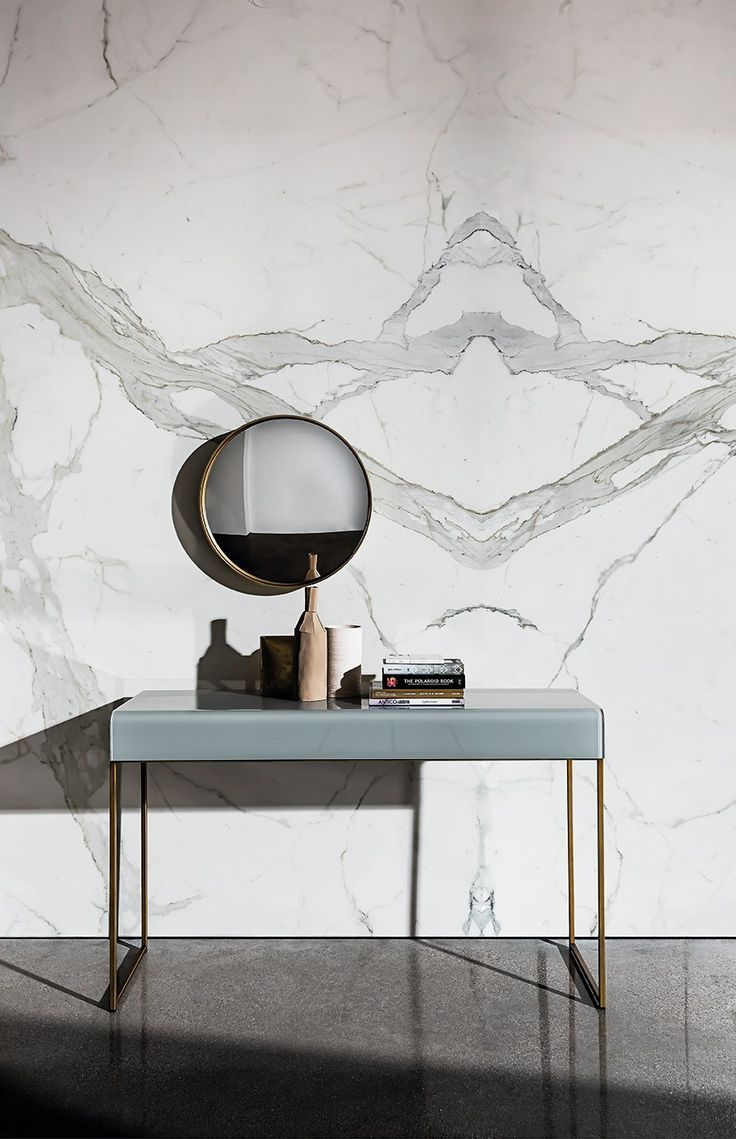 Opaque, grey glass adds a smokey look to this entryway table. Rectangular glass console table by NIDO.
