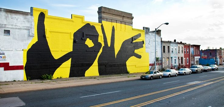 The Baltimore Love Project expresses love by connecting people and communities acrossBaltimore City through love themed murals.    A few years ago, local artist Michael Owen, developed a design of four hands spelling out theword love. (see above graphic) Now this image will be painted on 20 walls, spread evenly acrossthe communities of Baltimore City. The murals will be identical in regards to content, only rangingin size.