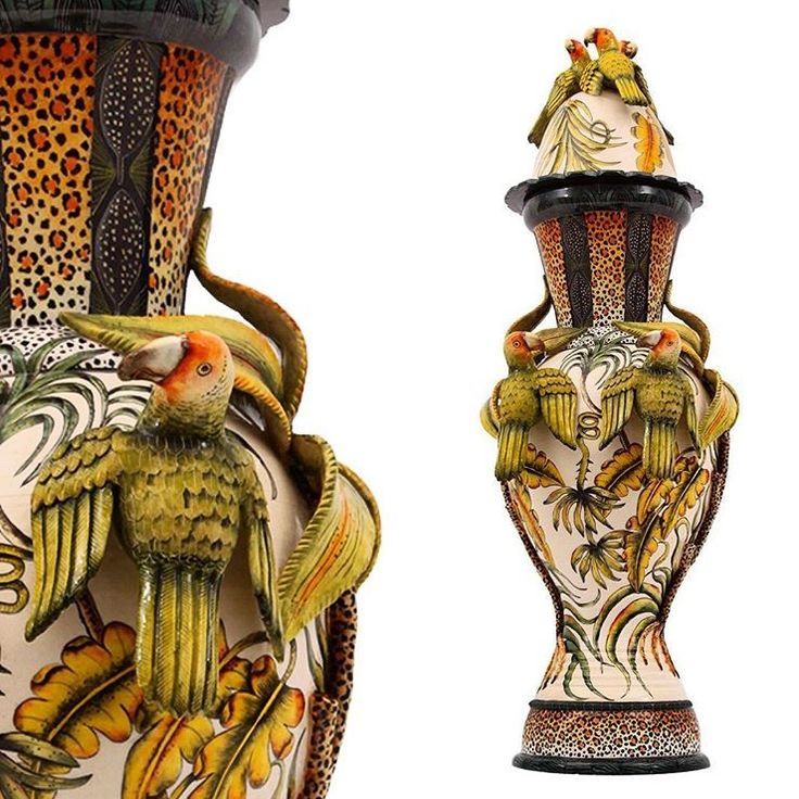 An elegant, tropical Lilian's Lovebird urn, made by Thabo Mbele and painted by Mthulusi Ncube.