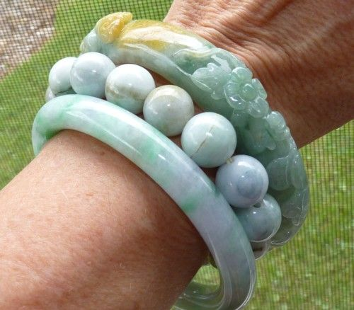 """An option of wearing two jade bangles on the same wrist, one smooth and one carved.  Looking at this photo, I would choose a smaller size jadeite bead bracelet for the """"spacer"""".  Lots of jade to play with if I get anxious, or need a distraction.  Option #11"""