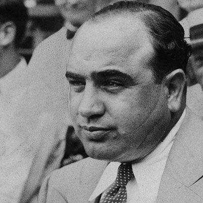 Al Capone (a.k.a. 'Scarface'), one of the most famous American gangsters, rose to infamy as the leader of the Chicago mafia during the Prohibition era. Before being sent to Alcatraz Prison in 1931 from a tax evasion conviction, he had amassed a personal fortune estimated at $100 million dollars and was responsible for countless murders.