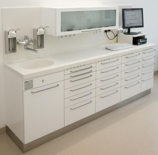 A middle section of counter with no under cabinets so lab stool could fit under it for extract prep. The computer setup could work.