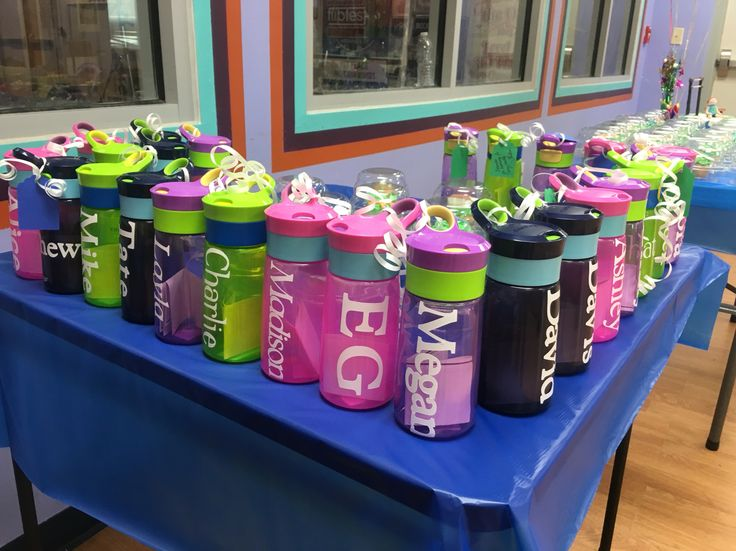 Party favors for a gymnastics party.  I found these Contigo water bottles in boy and girl colors and ordered them from Amazon.  I used my Cricut and adhesive vinyl sheets to make the names.  The kids loved their personalized water bottles!