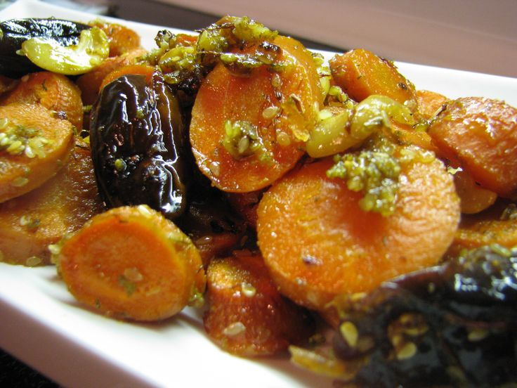 Baked carrots with coconut oil,saffron, dates, cashews, and sesame seeds.