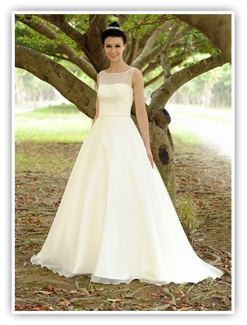 Available at StarDust Celebrations in Dallas, Texas. Hailing from a British design team, stylish Augusta Jones wedding gowns are created with the modern bride in mind. When designer Charlotte Leung launched the line in 1999, she focused on three essential requirements: beautiful styling, flexibility of the range to flatter a variety of shapes and affordability.