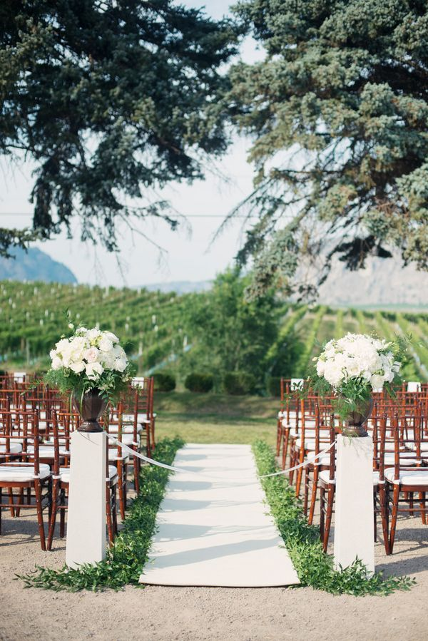 Edgy Petals - Greenery Lined Aisle | photography by http://melissagidneyphoto.com