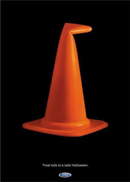 Simple, effective use of imagery - may have been better if the traffic cone had the usual reflective strip
