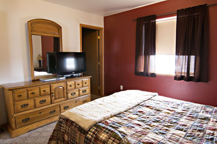 Clean and simple! The master bedroom of 305 W Tonk St Gillette, WY features an on-suite bath and large closet. Call Team Properties Group for your showing 307.685.8177
